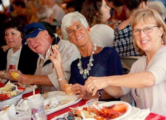 York, ME: Diners at a catered lobster and clambake for United Way of Bedford NH