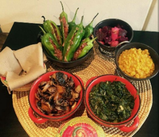 South Orange, NJ: Lalibela Tips Entree along with sides of collard greens, potato salad, and more.
