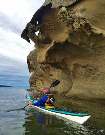 Eastsound, WA: Co-owner, Jeff Z, paddling around Sucia Island. Sandstone formations there are fantastic!