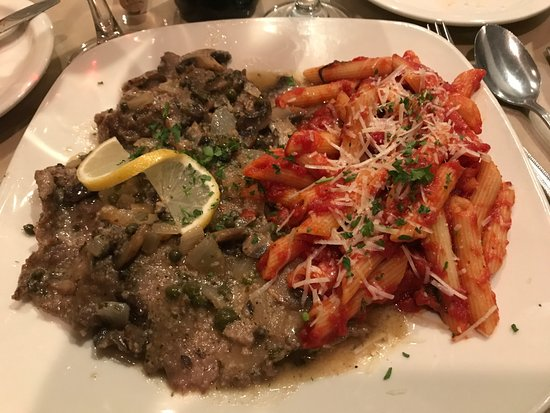 "Papa Gianni's Ristorante: Plate busting portion of veal piccata with ""side"" of penne. It is actually bigger than this look"