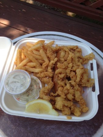 Chatham, MA: You know it's gonna be good when there are so many clams you can't see the roll! Yum!