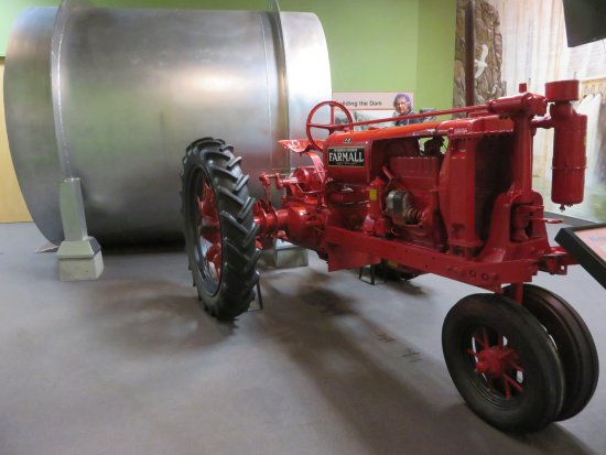 Ontario, OR: F-12 Farmall tractor, and a giant pipe used in dam construction