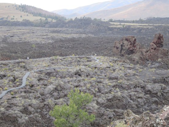 Arco, ID: Paved walking trail winds through the lava field