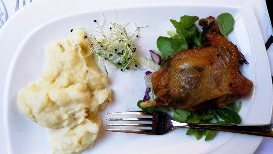 Duck leg with mash with truffle cream