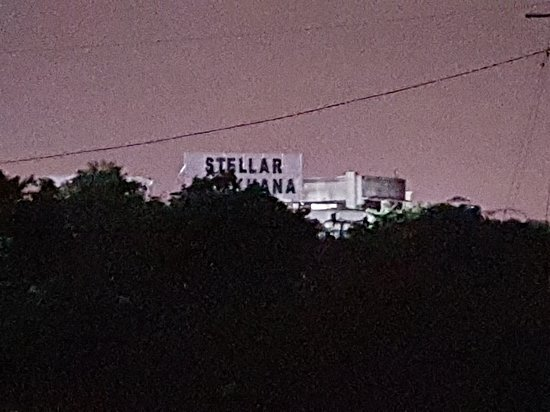 Greater Noida, India: View from the service road outside The Stellar Gymkhana