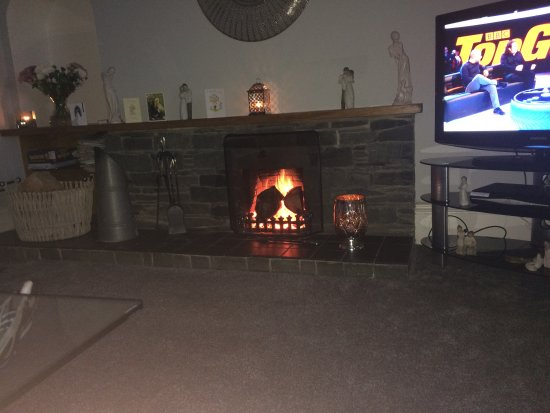 Stranraer, UK: Cosy fire in guests lounge
