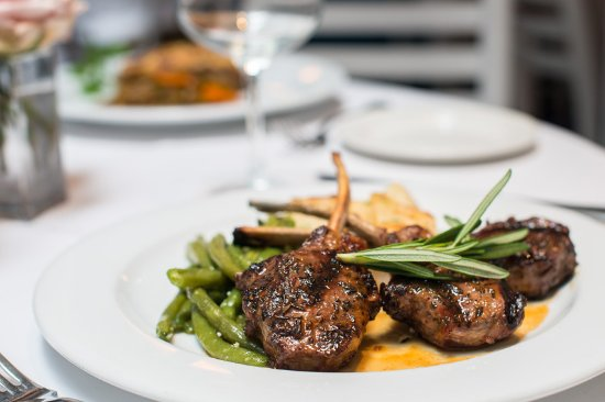 Periyali: Our juicy lamb chops served with rosemary and veggies