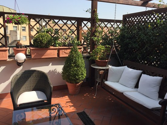 Althea Inn Roof Terrace: The balcony and breakfast on it