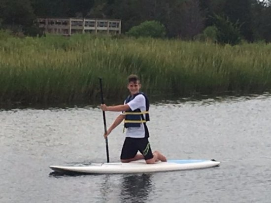 West Dennis, MA: My son Connor paddle boarding
