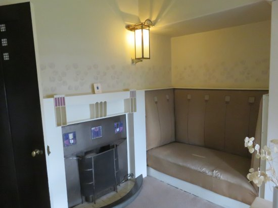 Master bedroom fireplace and seat at Hill House - Picture of ...
