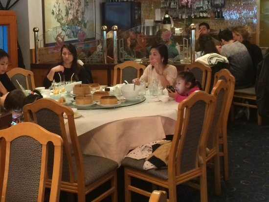 Oriental City: Family group eating is routine here