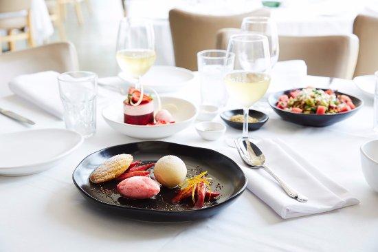 Elwood, Australia: Raspberry madeleine, house berry sorbet, white chocolate orb, rhubarb compote