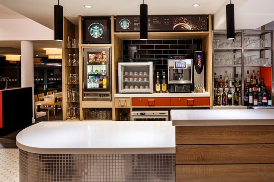 we proudly serve starbucks picture of holiday inn. Black Bedroom Furniture Sets. Home Design Ideas