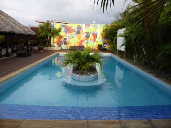 The Espiritu: Pool and mural. White screen on right is where they showed football game.