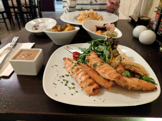 Mgarr, Malta: Chicken with pepper sauce and risotto in the background