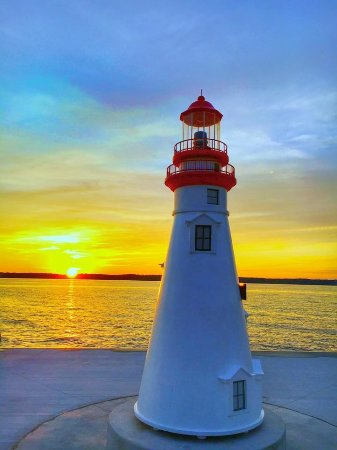 Alden, MI: Sunset at the Lighthouse located just a block from the Inn at Torch Lake.