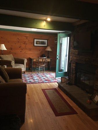 Chestertown, NY: Suite, fireplace, couches & chairs leading to deck