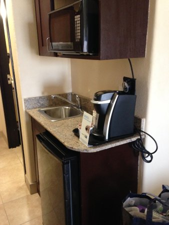 Brownfield, TX: Frig, coffee maker and microwave in room.