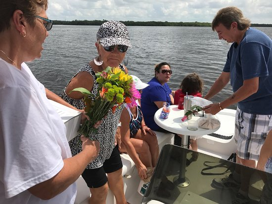 Matlacha, FL: Burial at sea for Skipper, family and friends said good by to our friend . Skip had the coconut