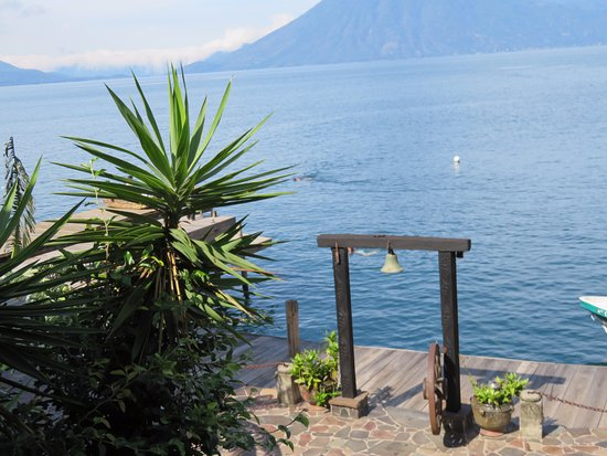 Laguna Lodge Eco-Resort & Nature Reserve: From my balcony - Laguna Lodge dock, Lake Atitlan 3 volcanoes can be seen.