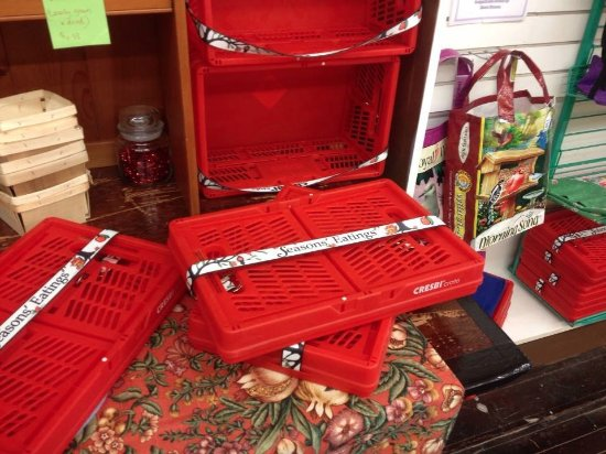 Napoleon, OH : Collapsible crates with a sturdy strap.  Makes it easy to be green! :)