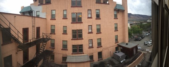 The Plaza Hotel: The view from our room - fire escapes/air-con units and the car park next door.