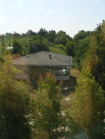 Holiday Inn Express Milan-Malpensa Airport: View of the local cemetery and abandoned luxury house