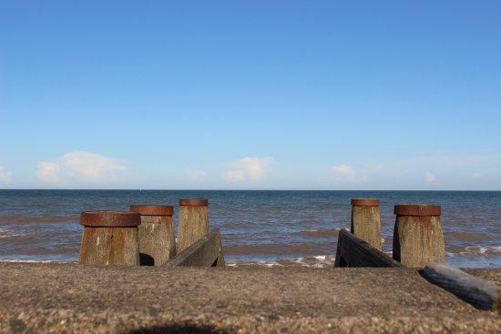 Hornsea, UK: Beach ladders and water.