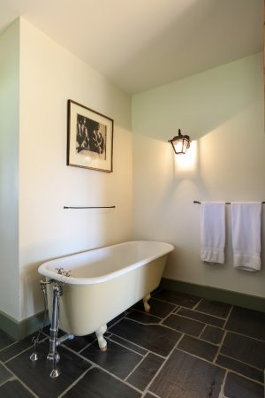 Addison, VT: Full Bath includes separate cast-iron tub and tiled shower.