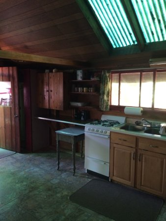 Conway, NH: Kitchen. Cabinet to left contains plates, pots, etc. Propane stove - 4 burners with oven.