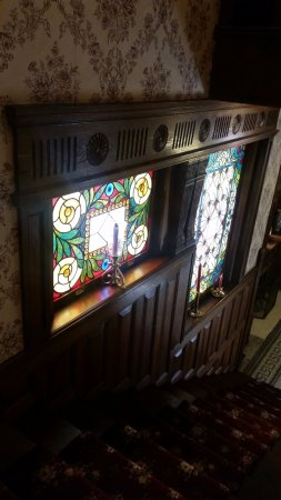 Rocking Horse Manor Bed and Breakfast: Stained glass by stairs