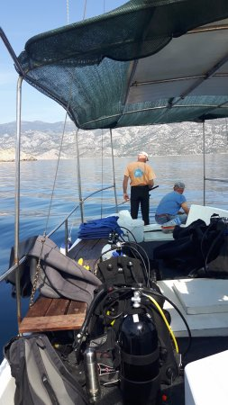 Island of Pag, Kroasia: Goran and Dubravko fishing while resting between the two dives of the day