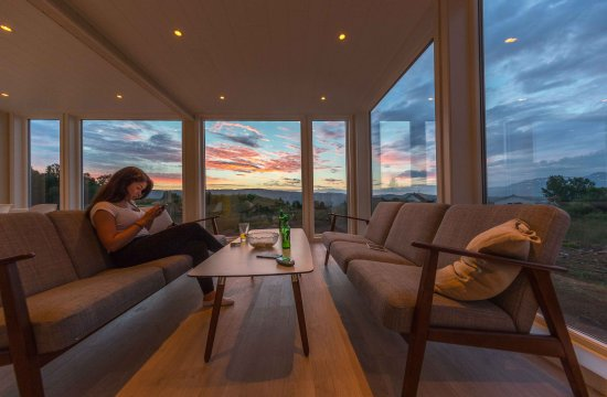 Senja, Norway: Enjoy the aurora from the inside of our glass panorama buildings
