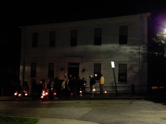 Plymouth, MA: Participants carrying gas lanterns on ghost tour...