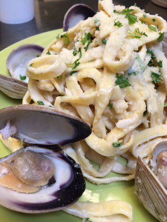 Fenton, MI: Linguine tossed in a creamy clam sauce and topped with littleneck clams and Parmesan.