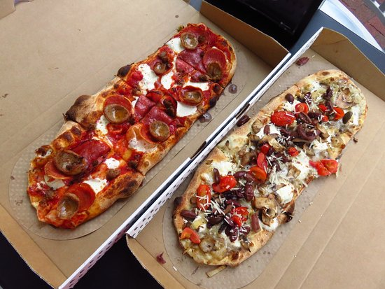 Bethesda, MD: Meatlovers and mushroom with tomato pizzas