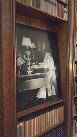 Lenox, MA: Photograh of a posed Wharton in her library.