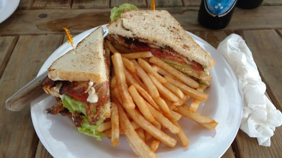 Bodden Town, Grand Cayman: Pork Belly sandwich with lots of fries
