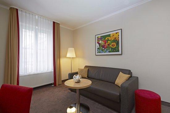 Gemütliche Sitzecke in der Suite Spiessberg vom H+ Hotel & SPA Friedrichroda