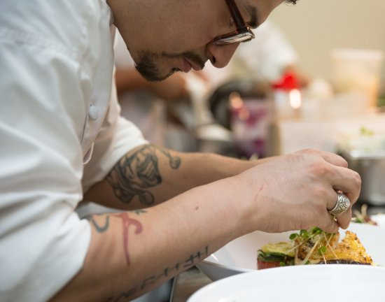 City Kitchen: Executive Chef Jessie Flores Carefully Plating In The CK  Kitchen