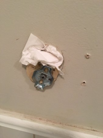 Jarrett House: hole in the bathroom wall