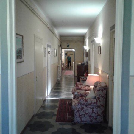 Bellevue House: Luciano, the owner, at the end of hallway