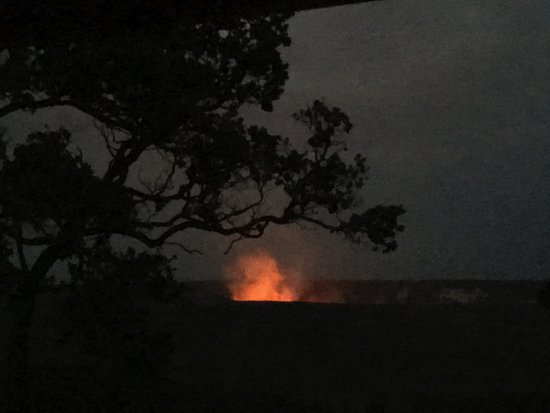 Volcano House: The view from our room -- Seeing lava reflected in the steam from our hotel room was a thrill fo