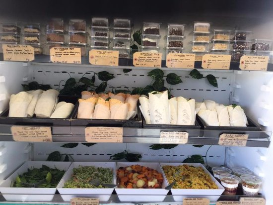 Body Fuel: A cabinet full..showing our homemade salads, wraps and cakes