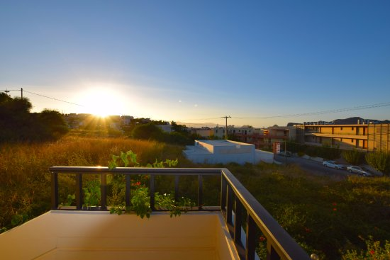 Merabello Apartments: View of the sunset from our balcony