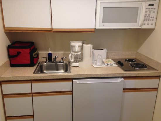 Ocean 7: clean & well stocked kitchen area with pots, dishes, utensils. Nice size fridge & freezer