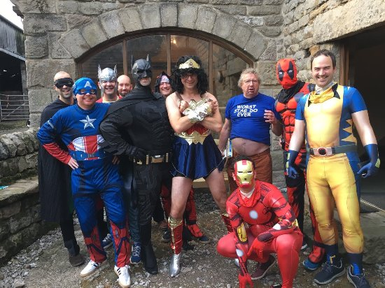 Bamford, UK: Stag as wonderwoman with comic book guy and selection of superheroes