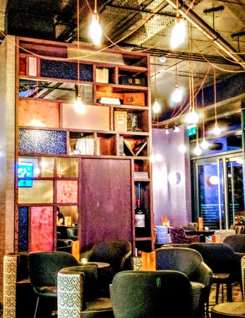 M Bar's seating area decor is wonderfully eclectic, making use of the high ceilings and fab ligh