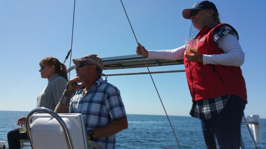 Central Coast Sailing Charters: Captain Mark, Randi and Rona scanning the horizon for whales