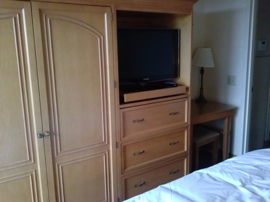 Hilton Boca Raton Suites: TV and Armoire in Bedroom